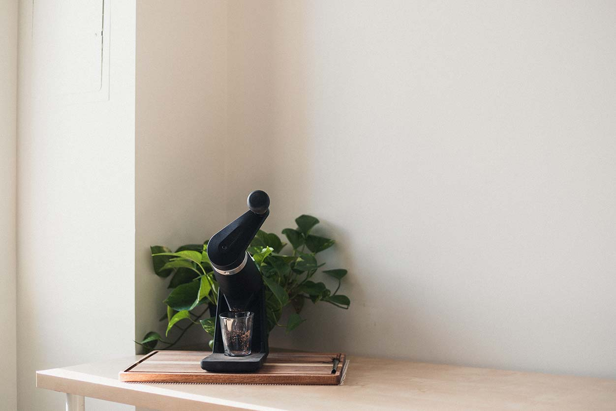 orphan espresso apex on a cutting board next to a houseplant